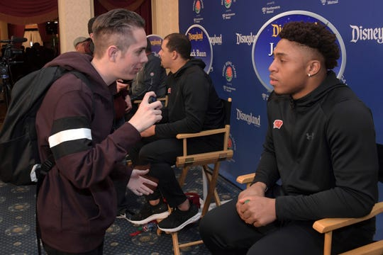 Fifteen50 Sports reporter Blake Atwell  interviews Wisconsin Badgers running back Jonathan Taylor during the Disneyland Rose Bowl Team Visit on Dec. 26, 2019, in Anaheim, California.