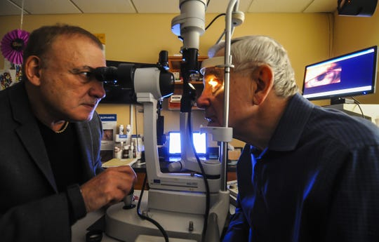 Optometrist Eye Doctor Steve Silberberg of Matawan, who is retiring after 40 years, uses a Slit Lamp Bio Microscope to examine Ed DeNoble of Ocean, his last patient and who was also his first patient 40 years ago at his office in Matawan on Dec. 28, 2019.