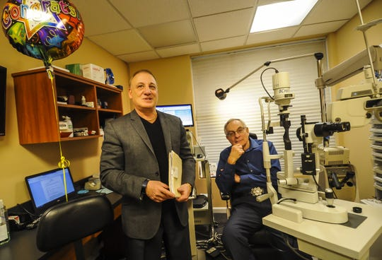 Optometrist Eye Doctor Steve Silberberg of Matawan, who is retiring after 40 years, with Ed DeNoble of Ocean, his last patient and who was also his first patient 40 years ago at his office in Matawan on Dec. 28, 2019.