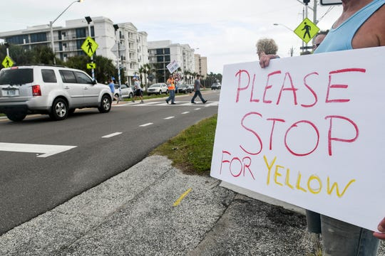 In a photo from December 2019, protesters gather at the corner of Ellwood Avenue and A1A to draw attention to the pedestrian crosswalk installed at the intersection and to advocate for a different kind of warning system. Sophia Nelson, 12, was struck and killed by a vehicle Dec. 22 despite the newly installed warning lights at the intersection.