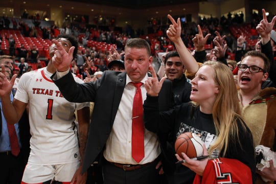 Dec 16, 2019; Lubbock, TX, USA; Texas Tech Red Raiders head coach Chris Beard celebrates a victory over the Southern Mississippi Golden Eagles with the student body at United Supermarkets Arena. Mandatory Credit: Michael C. Johnson-USA TODAY Sports