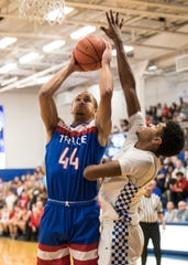 Zane Trace's Triton Davidson takes it to the rim against Chillicothe Friday night at Chillicothe High School.