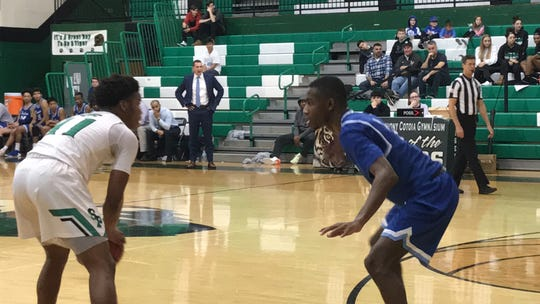 South Plainfield's Destiny Nwankwo (left) looks to get around the defense of Scotch Plains-Fanwood's Justin Grey during the Anthony J. Cotoia Holiday Tournament final on Friday, Dec. 27, 2019.