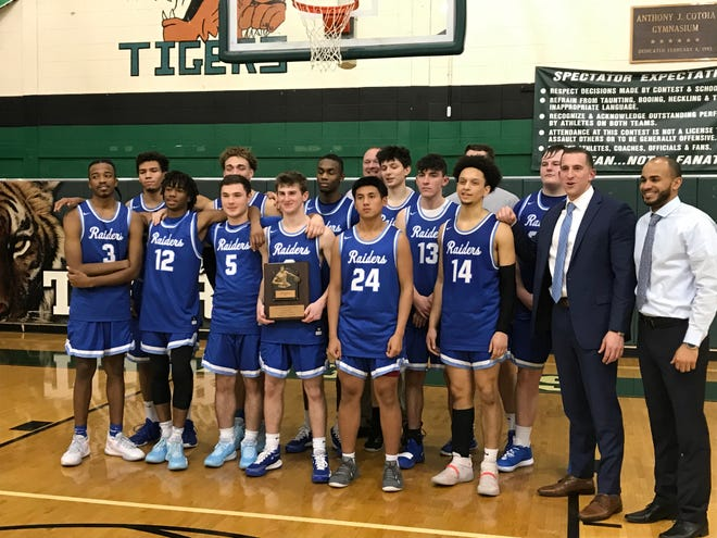 The Scotch Plains-Fanwood boys basketball team beat South Plainfield 56-49 to win the Anthony J. Cotoia Holiday Tournament on Friday, Dec. 27, 2019.