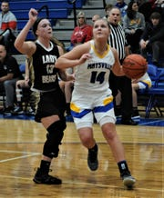 Maysville's Bailee Smith drives towards the bucket in Saturday's game. She scored a school-record 40 points in Maysville's 75-29 win.