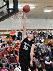 Ridgewood senior Trey Stoffer goes up for a layup during a regular season win against Coshocton at the River View Holiday Classic. Stoffer earned third-team All-Ohio by the Ohio Prep Sportswriters Association on Monday.