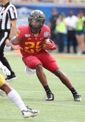 Iowa State Cyclones running back Rory Walling (29) runs with ball against the Notre Dame Fighting Irish during the first quarter at Camping World Stadium.
