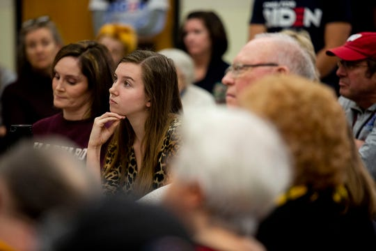 A woman listens to Former Vice President Joe Biden, Democratic presidential candidate, on Friday, Dec. 27, 2019, at the Williamsburg High School in Williamsburg, Iowa.