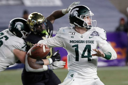Michigan State's Brian Lewerke throws a pass during the second half of the Pinstripe Bowl against Wake Forest on Friday, Dec. 27, 2019, in New York. Michigan State won 27-21.