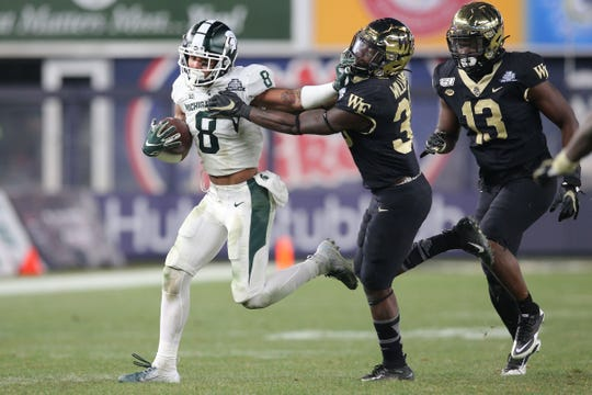 Jalen Nailor runs with the ball against Wake Forest during the fourth quarter of the Pinstripe Bowl at Yankee Stadium.