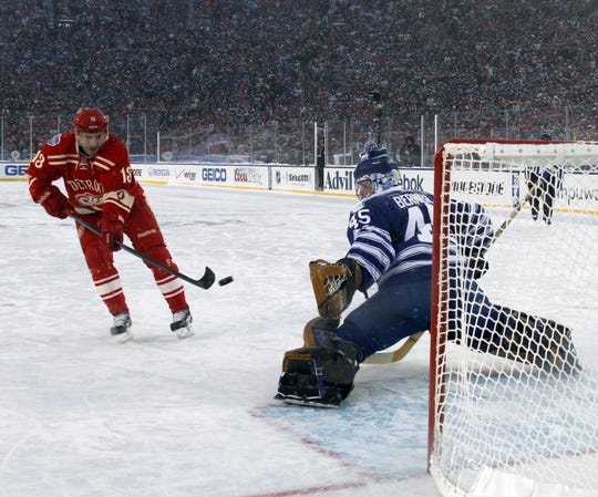 Red Wings' Pavel Datsyuk scores during the shootout at the Winter Classic at Michigan Stadium in Ann Arbor on Jan. 1, 2014. The Wings lost 3-2.