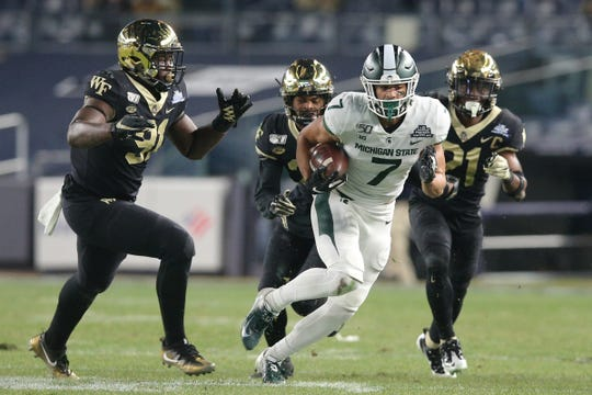 Michigan State receiver Cody White runs with the ball against Wake Forest during the third quarter of the Pinstripe Bowl at Yankee Stadium, Friday, Dec. 27, 2019, in New York.