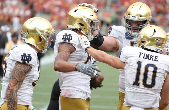 Notre Dame wide receiver Chase Claypool, middle, celebrates with teammates after a touchdown during the Camping World Bowl against Iowa State Saturday at Camping World Stadium in Orlando, Fla.