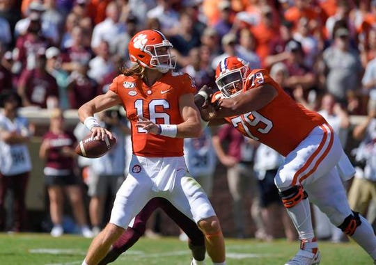 Clemson quarterback Trevor Lawrence, above, will be matched up against Ohio State's star defensive lineman Chase Young tonight.