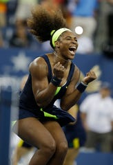 Serena Williams reacts after beating Victoria Azarenka, of Belarus, in the championship match at the 2012 US Open tennis tournament Sept. 12, 2012, in New York.