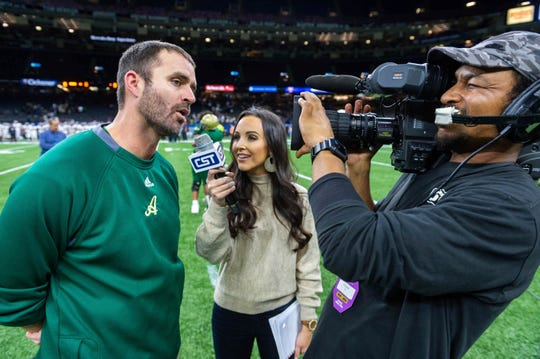 Acadiana head coach Matt McCullough, left, speaks with Carley McCord, center, following a win over the Destrehan in the State Division 5A Championship football game Dec. 14 in Lafayette, La.