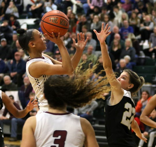 Elmira's Kiara Fisher drives the paint as Cardinal O'Hara's Alex Buckley defends during the Hawks' 56-51 win over Elmira in the girls division of the Josh Palmer Fund Elmira Holiday Inn Classic on Dec. 27, 2019 at Elmira High School.
