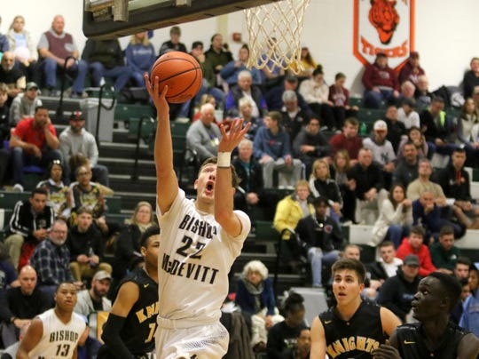 Jake Kelly of Bishop McDevitt (Harrisburg, Pennsylvania) goes up for a layup against Rochester McQuaid in a National Division quarterfinal at the Josh Palmer Fund Elmira Holiday Inn Classic on Dec. 28, 2019 at Elmira High School.