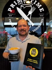 David Parker of Prime Time Pub and Grill with awards from the Evansville Burger Brawl and Mac & Cheese Festival won in 2019.