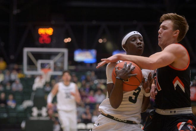 Colorado State basketball player Kendle Moore has the ball stripped during a game against Doane at Moby Arena on Saturday, Dec. 28, 2019.