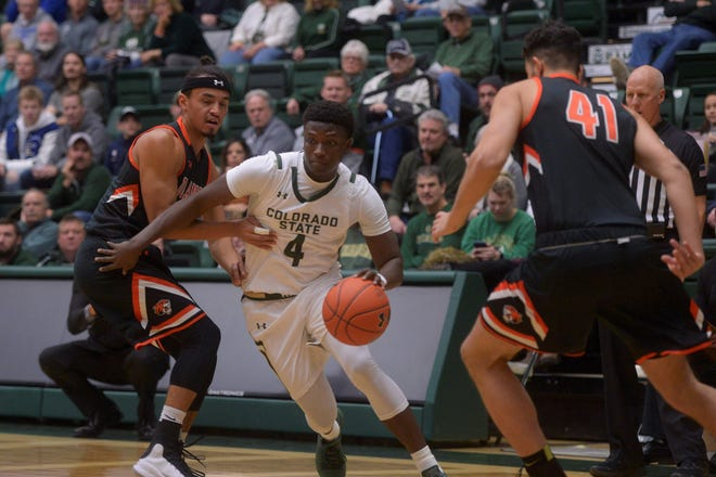 Colorado State basketball player Isaiah Stevens dribbles past defenders during a game against Doane at Moby Arena on Saturday, Dec. 28, 2019.