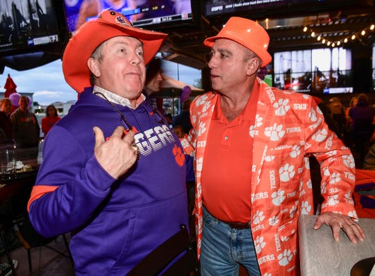 "Dean ""The Hat"" Cox, left, and John Moore, right, of Charleston, both who attended the 1981 National Championship, talk about their hats and attire joining in at the Arizona Clemson Club and Clemson Alumni Association party at K O'Donnell's Bar and Grill in Scottsdale, Arizona Friday December 27, 2019."