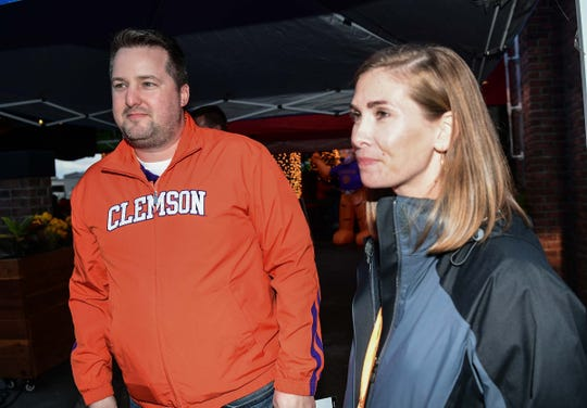 Steven Jackson, left, and Liz Jackson, right, of the Arizona Clemson Club during a gathering before The Fiesta Bowl at K O'Donnell's Bar and Grill in Scottsdale, Arizona Friday December 27, 2019.