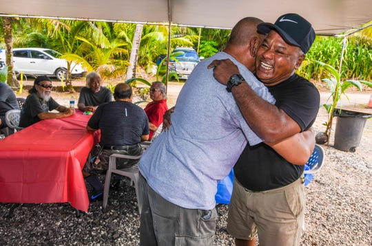 "Guam Power Authority Lead Lineman Jose Quinata hugs retiree A.C. Rock upon his arrival to his home on Swamp Road, Dededo, during a party for GPA retirees, on Saturday, Dec. 28, 2019. Quinata said he organized the get together because he ""really missed the guys"" some of which he described as ""pioneers"" during their time with the agency."