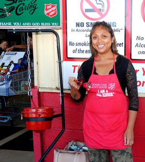 Keena Usalla of Tamuning at work Dec. 27, ringing bells to raise money for the Salvation Army at the Tamuning Cost-U-Less.