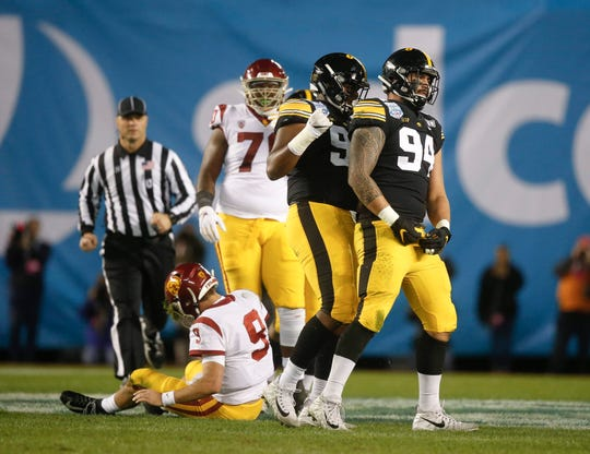 A.J. Epenesa (94) finished his career at Iowa as the defensive MVP of the Holiday Bowl, after recording 2.5 sacks in a 49-24 win against USC.