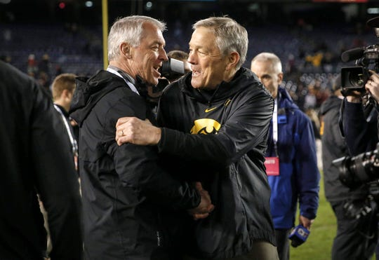 Iowa athletics director Gary Barta, left, and football coach Kirk Ferentz embrace after the last football game played by the school, the Dec. 27 Holiday Bowl.