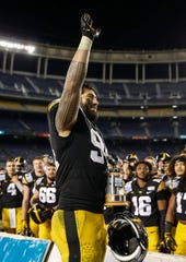 Iowa junior defensive end A.J. Epenesa waves to his family in the stands after helping the Hawkeyes to a 49-24 win over USC during the Holiday Bowl on Friday, Dec. 27, 2019, at the SDCCU Stadium in San Diego, Calif.
