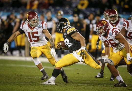 Iowa running back Toren Young runs the ball in the fourth quarter against USC during the Holiday Bowl on Friday, Dec. 27, 2019, at the SDCCU Stadium in San Diego, Calif.