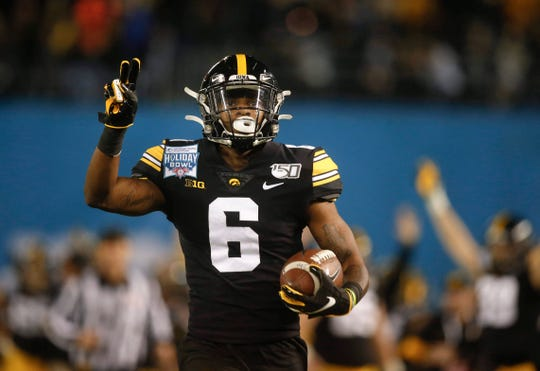 Iowa's Ihmir Smith-Marsette returns a 98-yard kickoff for a touchdown in the second quarter against USC during the Holiday Bowl on Friday, Dec. 27, 2019, at the SDCCU Stadium in San Diego, Calif.