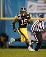 Iowa running back Tyler Goodson sprints for a 9-yard gain in the second quarter against USC during the Holiday Bowl on Friday, Dec. 27, 2019, at the SDCCU Stadium in San Diego, Calif.