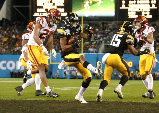 Iowa receiver Ihmir Smith-Marsette scored three touchdowns in the Holiday Bowl: one rushing, one receiving and one on a kickoff return.