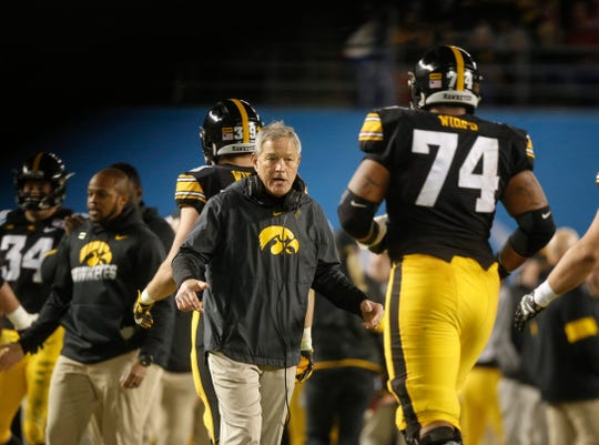 Iowa head football coach Kirk Ferentz celebrates a touchdown with his players against USC during the Holiday Bowl on Friday, Dec. 27, 2019, at the SDCCU Stadium in San Diego, Calif.