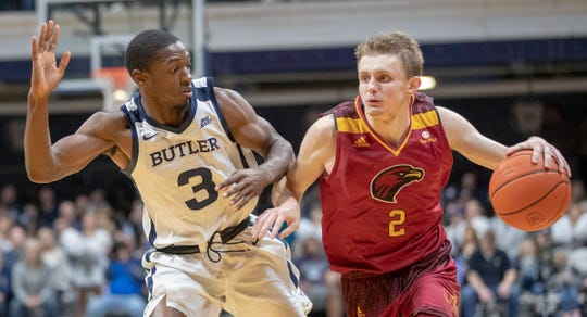 Kamar Baldwin of the Butler Bulldogs defends Michael Ertel of the Louisiana Monroe Warhawks, Louisiana-Monroe at Butler men's basketball, Hinkle Fieldhouse, Indianapolis, Saturday, Dec. 28, 2019. Butler won 67-36 as L-M shot 23% for the game.