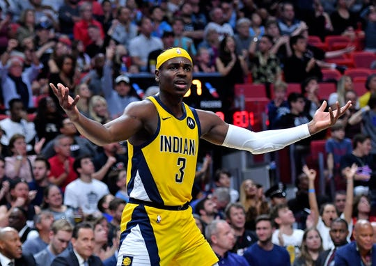 Pacers guard Aaron Holiday (3) reacts against the Miami Heat during the second half at American Airlines Arena.