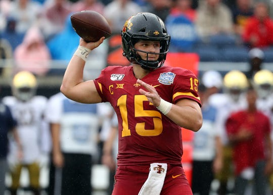 Dec 28, 2019; Orlando, Florida, USA; Iowa State Cyclones quarterback Brock Purdy (15) throws the ball against the Notre Dame Fighting Irish during the first half at Camping World Stadium. Mandatory Credit: Kim Klement-USA TODAY Sports