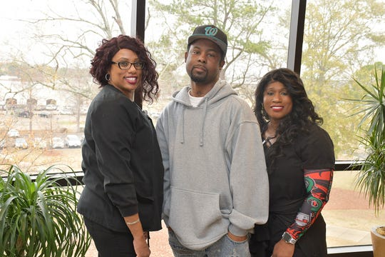 Methodist Specialty Care Center respiratory therapists Janisia Hutton, left, and Felisha Davis, right, were instrumental in helping Michael Jordan, center, wean off a ventilator and return home to Greenwood, Miss., on Dec. 18, 2019.