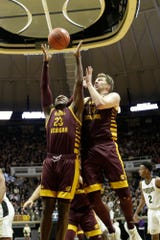 Central Michigan guard Dallas Morgan (23) and Central Michigan forward David DiLeo (14) go up for the rebound during the second half of a NCAA men's basketball game, Saturday, Dec. 28, 2019 at Mackey Arena in West Lafayette.