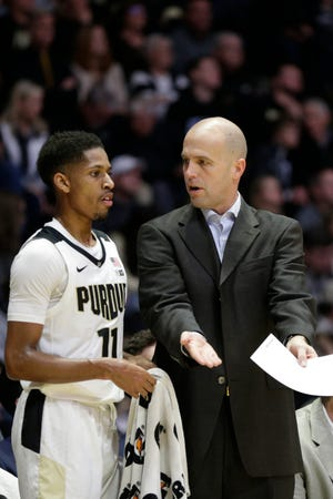 Purdue guard Isaiah Thompson (11) talks with Purdue assistant coach Steve Lutz during the first half of a NCAA men's basketball game, Saturday, Dec. 28, 2019 at Mackey Arena in West Lafayette.