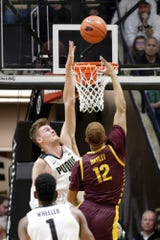 Purdue center Matt Haarms (32) attempts to block Central Michigan forward Kevin Hamlet (12)'s layup during the first half of a NCAA men's basketball game, Saturday, Dec. 28, 2019 at Mackey Arena in West Lafayette.