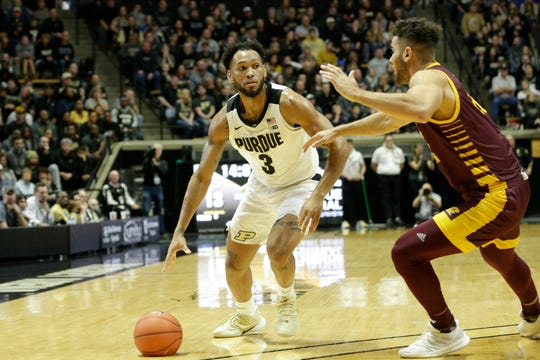 Purdue guard Jahaad Proctor (3) dribbles against Central Michigan guard Kevin McKay (20) during the first half of a NCAA men's basketball game, Saturday, Dec. 28, 2019 at Mackey Arena in West Lafayette.