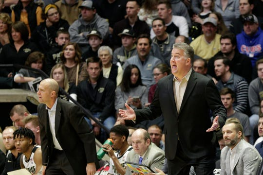 Purdue head coach Matt Painter reacts from the bench with Purdue assistant coach Steve Lutz during the first half of a NCAA men's basketball game, Saturday, Dec. 28, 2019 at Mackey Arena in West Lafayette.