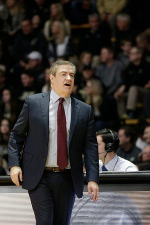 Central Michigan head coach Keno Davis reacts during the first half of a NCAA men's basketball game, Saturday, Dec. 28, 2019 at Mackey Arena in West Lafayette.