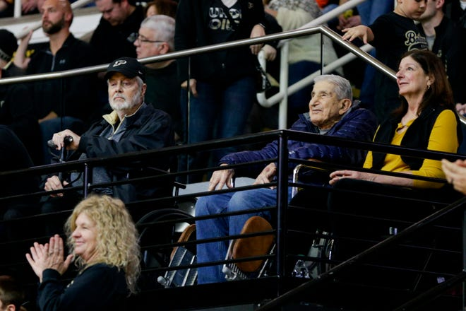 Bill Berberian, former Purdue basketball player and West Lafayette High School basketball coach, seated in a blue jacket, is honored during the first half of a NCAA men's basketball game, Saturday, Dec. 28, 2019 at Mackey Arena in West Lafayette.