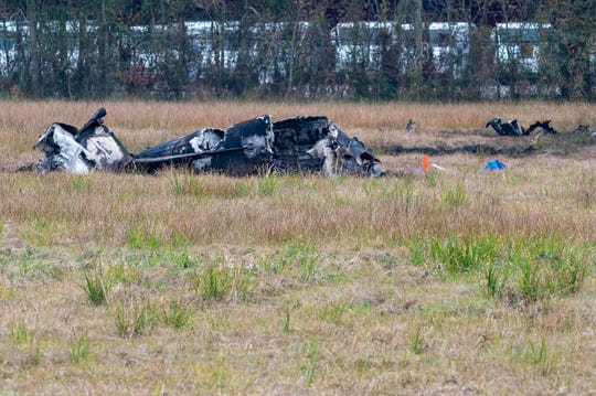 Fire and Police respond to the scene of a plane crash that crashed into a Post Office parking lot then skidded into an open field in Lafayette, LA. 5 people confirmed dead. Saturday, Dec. 28, 2019.