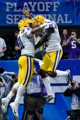 LSU tight end Thaddeus Moss (81) celebrates his touchdown against Oklahoma during the first half of the Peach Bowl NCAA semifinal college football playoff game, Saturday, Dec. 28, 2019, in Atlanta. (AP Photo/Danny Karnik)